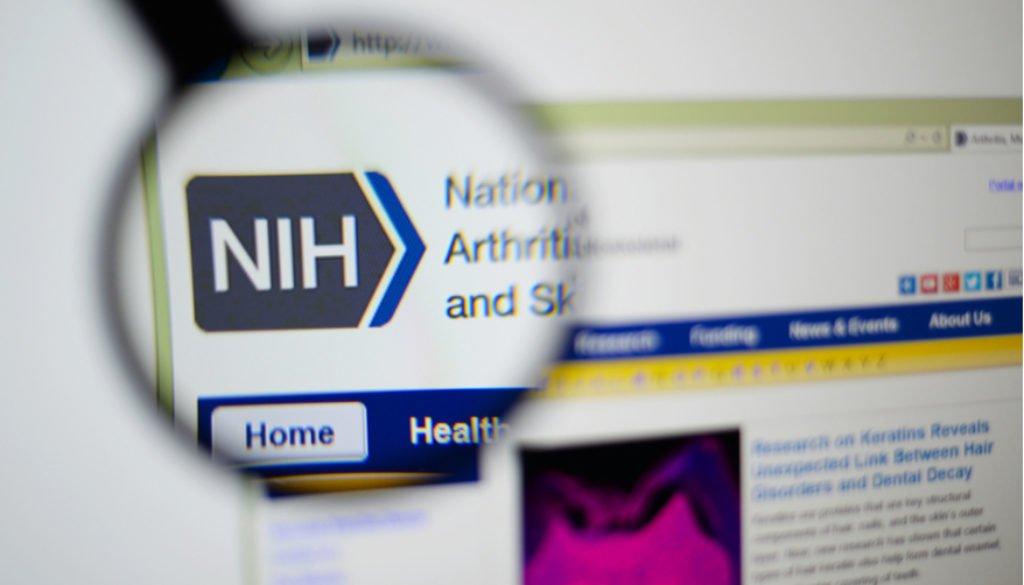 Magnifying glass over NIH logo