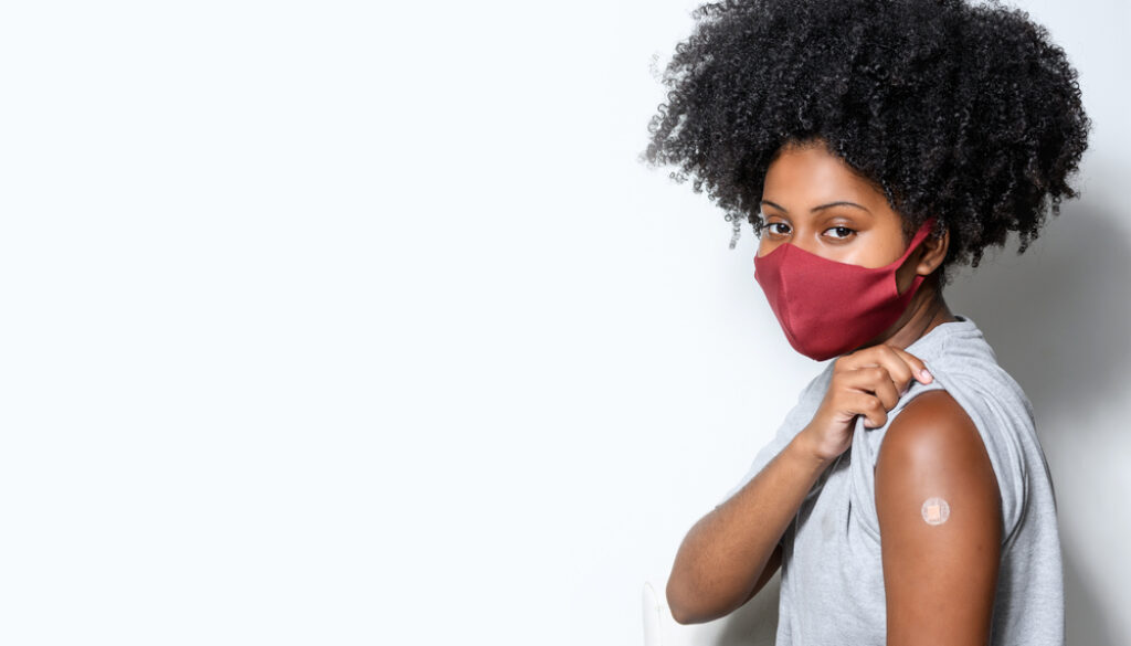 Black,Teenager,Wearing,Protective,Mask,Against,Covid-19,With,A,Smile